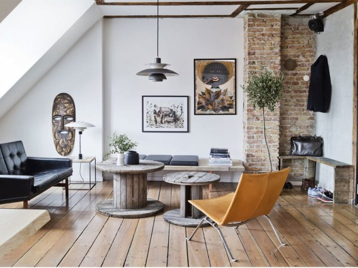 Apartamento de estilo industrial y ambiente masculino con vistas a Copenhague